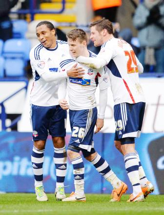 Neil Danns, left, celebrates with goalscorers Joe Mason, centre, and Lukas Jutkiewicz against Watford