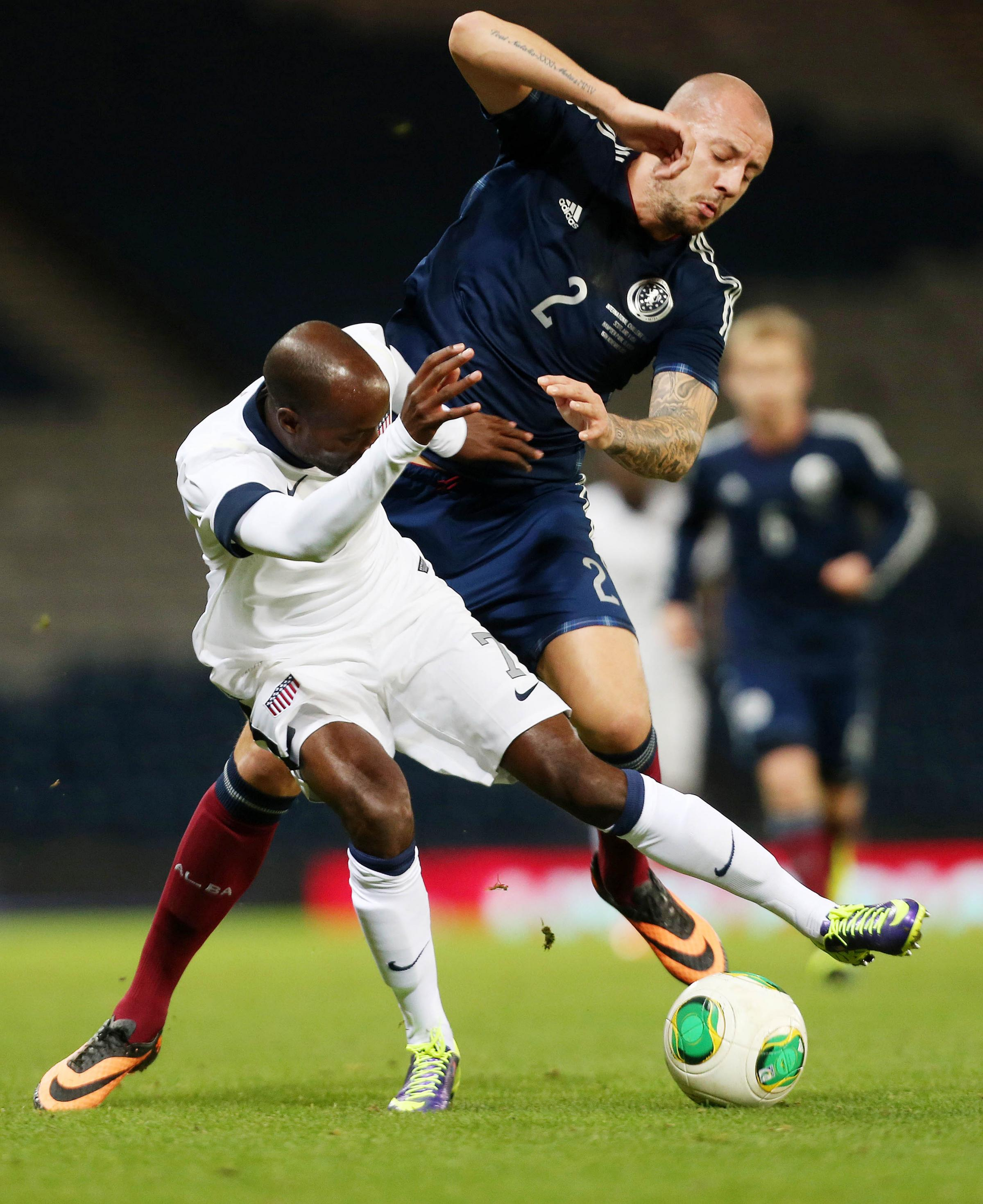 Scottish international Alan Hutton, right, has joined Wanderers on loan