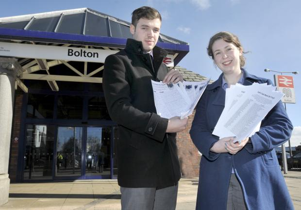Bolton News political reporter Elaine O'Flynn, and colleague Liam Thorp, with the petition that is going to No 10