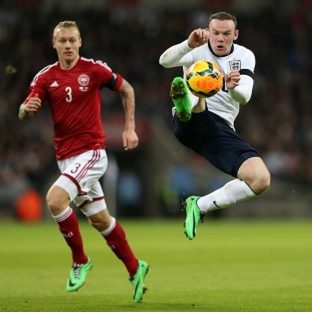 The Bolton News: Wayne Rooney, right, felt England fully deserved their victory over Denmark
