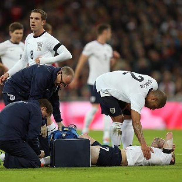 The Bolton News: Jack Wilshere is treated by medical staff