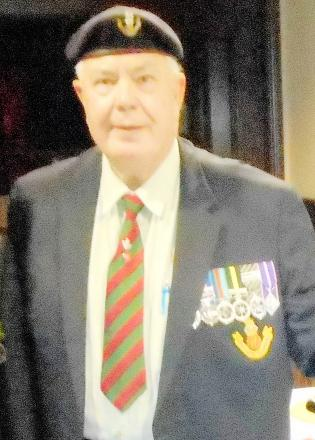 Malcolm Vickers with his medals