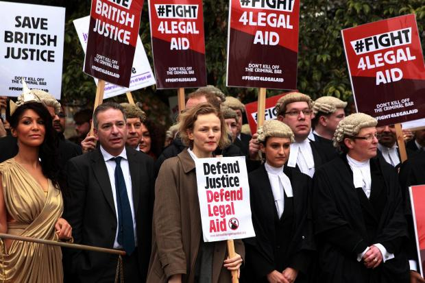 Actress Maxine Peake (centre) with protesters outside Westminster in London campaigning against legal aid cuts. Sean Dempsey/PA Wire
