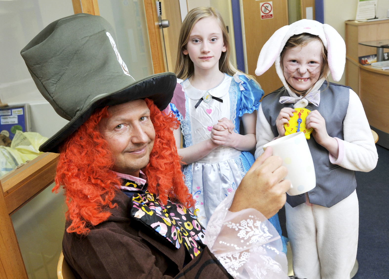 Washacre Primary School's business manager Carl Messenger with Amber Halliwell-Cliff and Tabatha Gilroy-Roberts