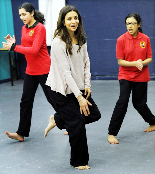 The Bolton News: Shobna and pupils try out some moves
