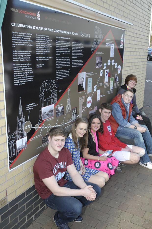 The Bolton News: Fred Longworth pupils show off the timeline that was unveiled to mark the occasion