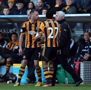 Newcastle manager Alan Pardew, right, confronts Hull's David Meyler