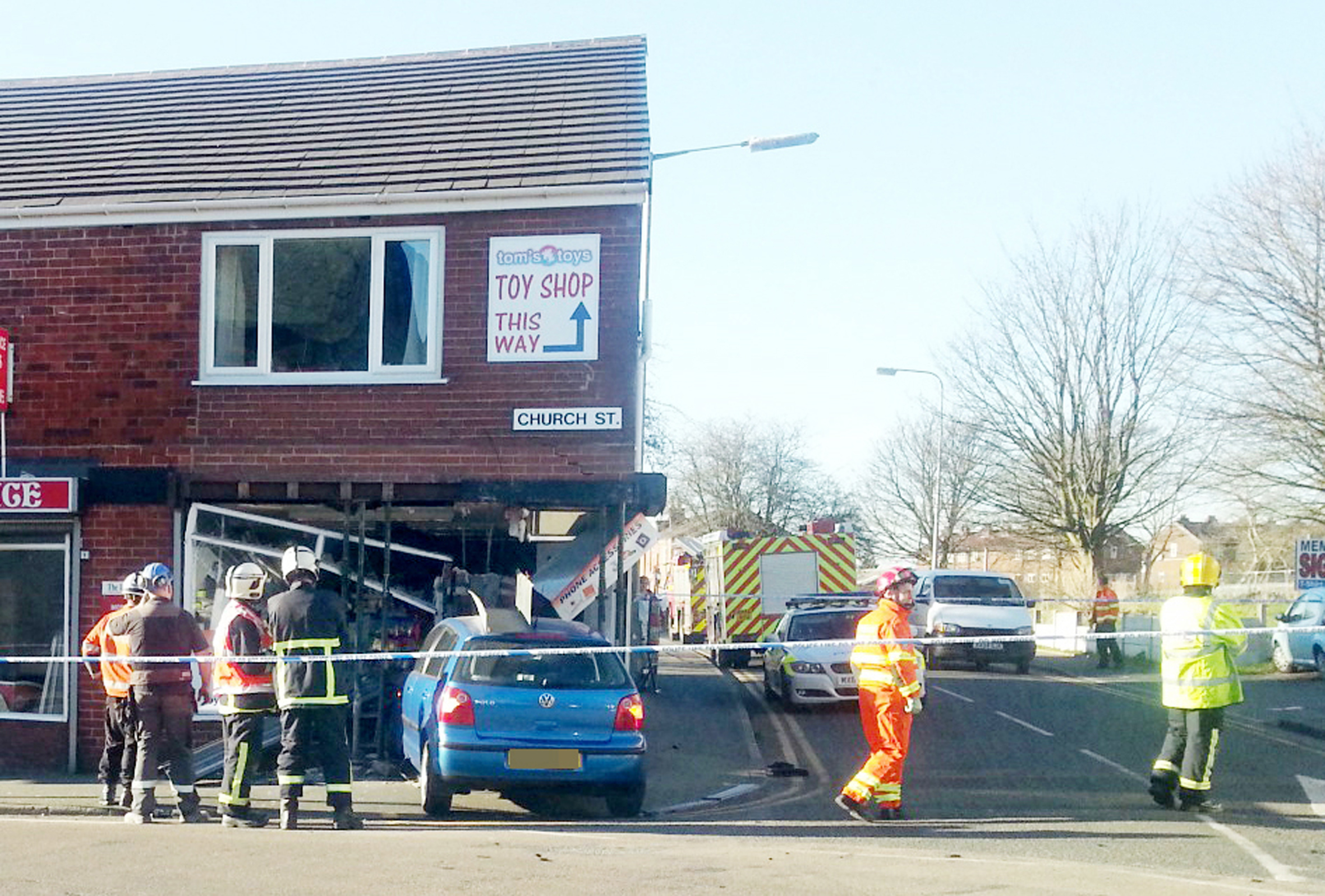 UPDATED: Car crashes into shop in Little Lever