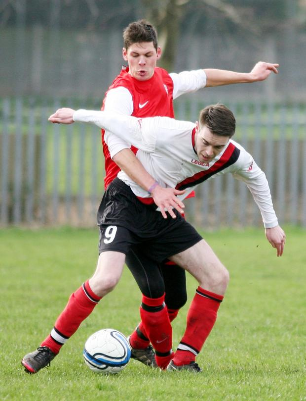 The Bolton News: Sean Haslam, of Prestwich, holds off Horwich Victoria's Sean Jones