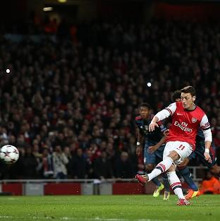 Arsene Wenger feels Mesut Ozil is finally over his penalty miss against Bayern Munich