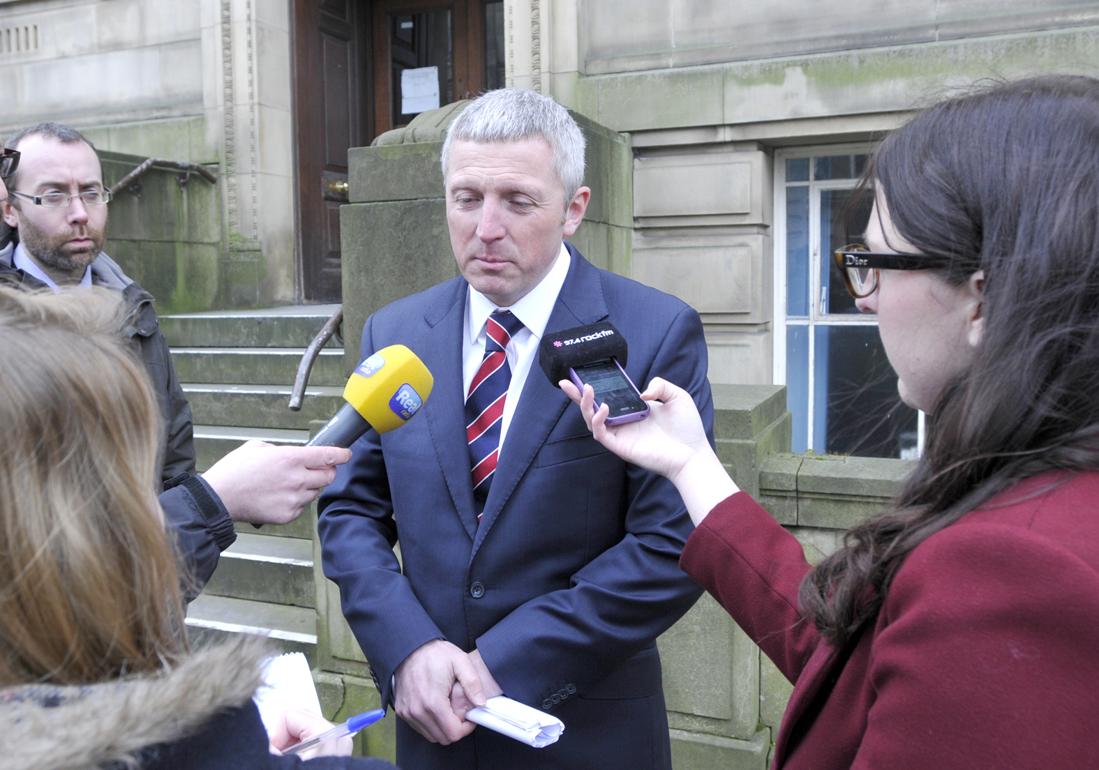 Det Insp Aaron Duggan speaking to the press outside Bolton Coroners Court today