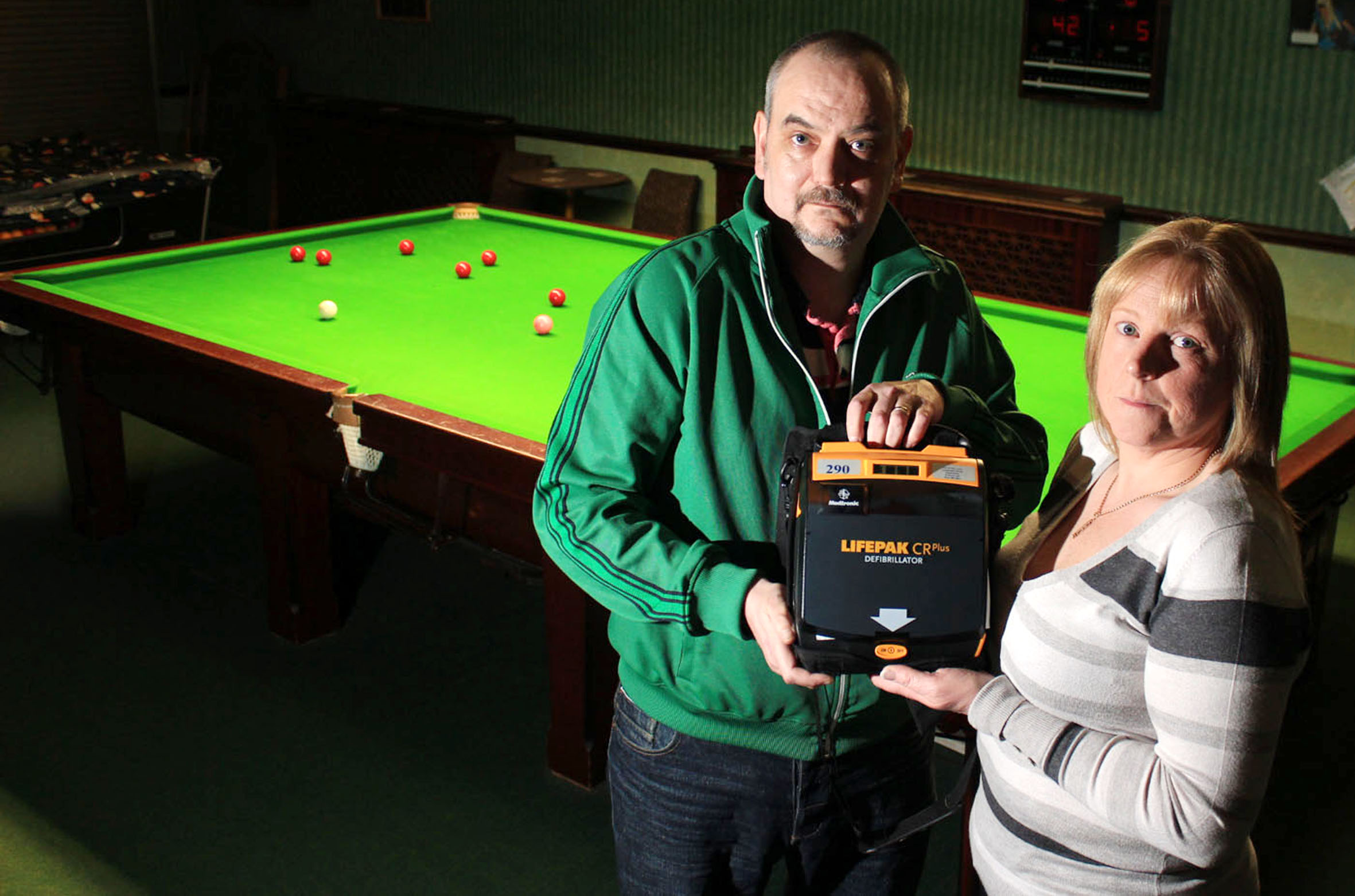 Club staff and customers save snooker player's life after he collapses during match