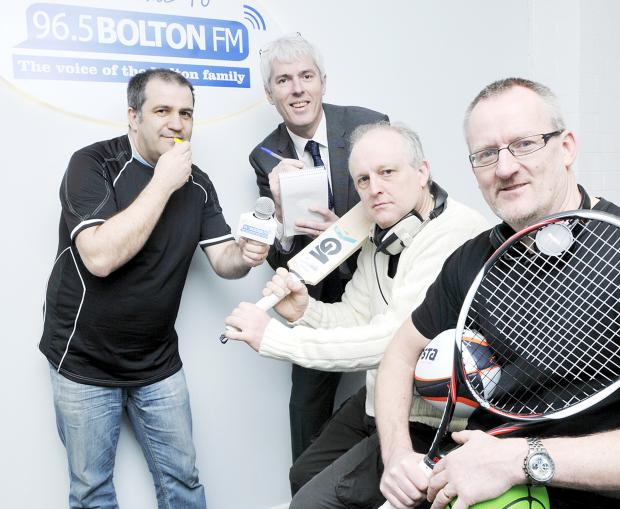 Boltonfm programme manager Andy Wilkinson and Neil Bonnar, head of sport at The Bolton News, left and second left, oversee presenters John Entwistle and Ross Elliot in their training for the marathon 12-hour broadcast