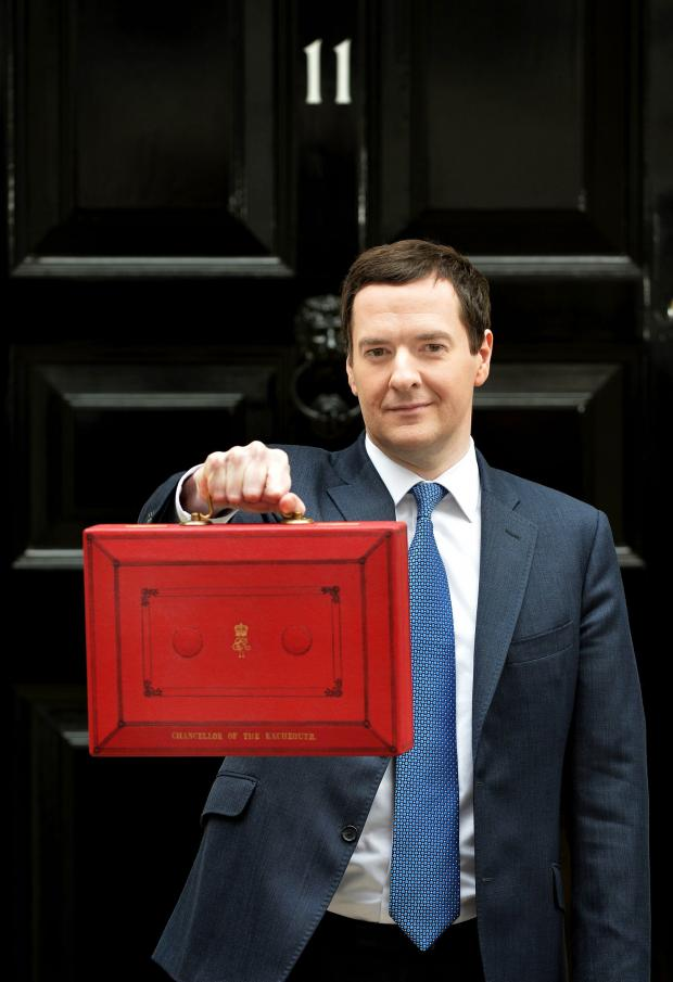 The Bolton News: George Osborne with the famous red budget box