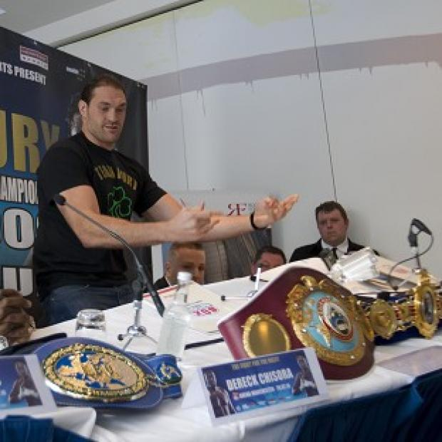 The Bolton News: Tyson Fury tosses the top table aside before walking out of the preview press conference for July's fight with Dereck Chisora (AP)