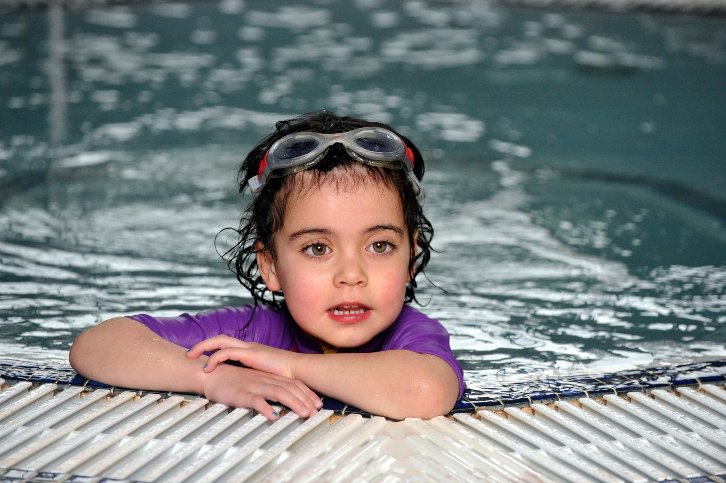 Brave heart operation girl is one of youngest in UK to swim 400 metres