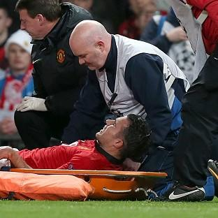 Stricken Robin Van Persie is out for as many as six weeks