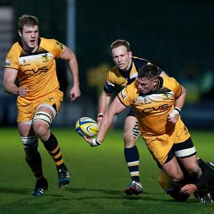 Tom Lindsay tries to get his pass away to Joe Launchbury at Sixways