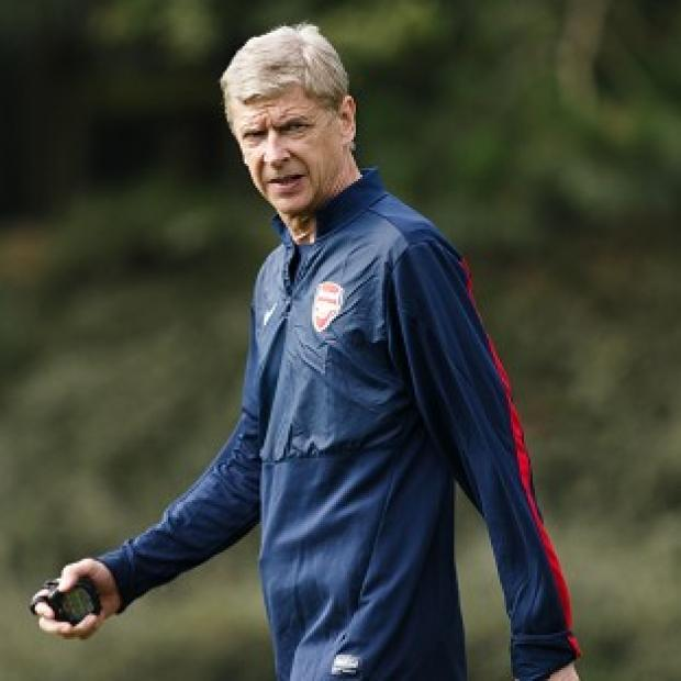 The Bolton News: Arsene Wenger says he has no plans to leave Arsenal