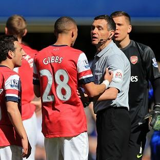 Kieran Gibbs appeals to referee Andre Marriner after his controversial red card
