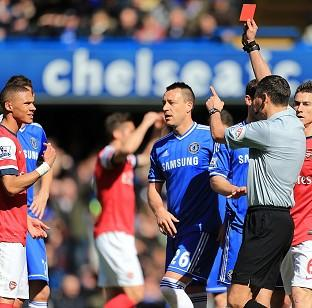 The Bolton News: Referee Andre Marriner showed a red card to Arsenal's Kieran Gibbs