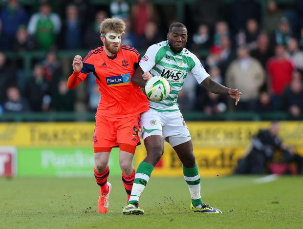 The Bolton News: Tim Ream battles Ishmael Miller
