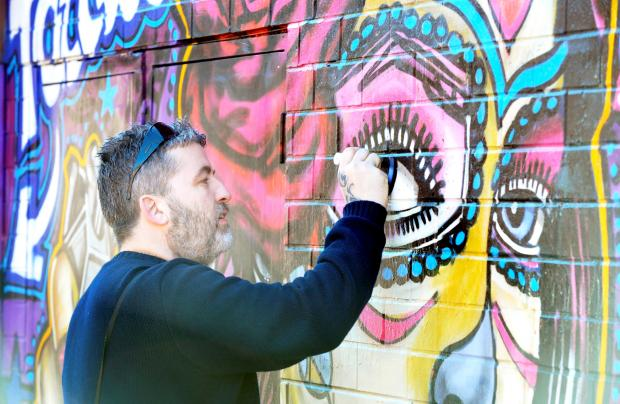 The Bolton News: Graffiti artist repairs his own work - after it was targeted by vandals