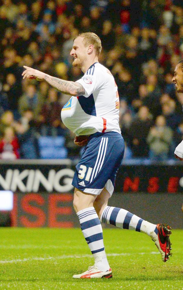 The Bolton News: David Wheater celebrates scoring Wanderers' matchwinner against Blackpool on Tuesday night