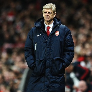 Arsene Wenger has not given up hope of winning the Premier League this season
