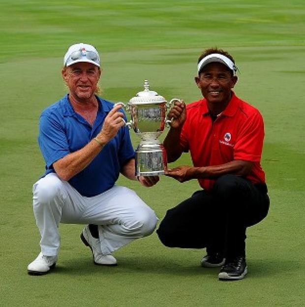 The Bolton News: Miguel Angel Jimenez, left, and Thongchai Jaidee, right, share the EurAsia Cup (AP)