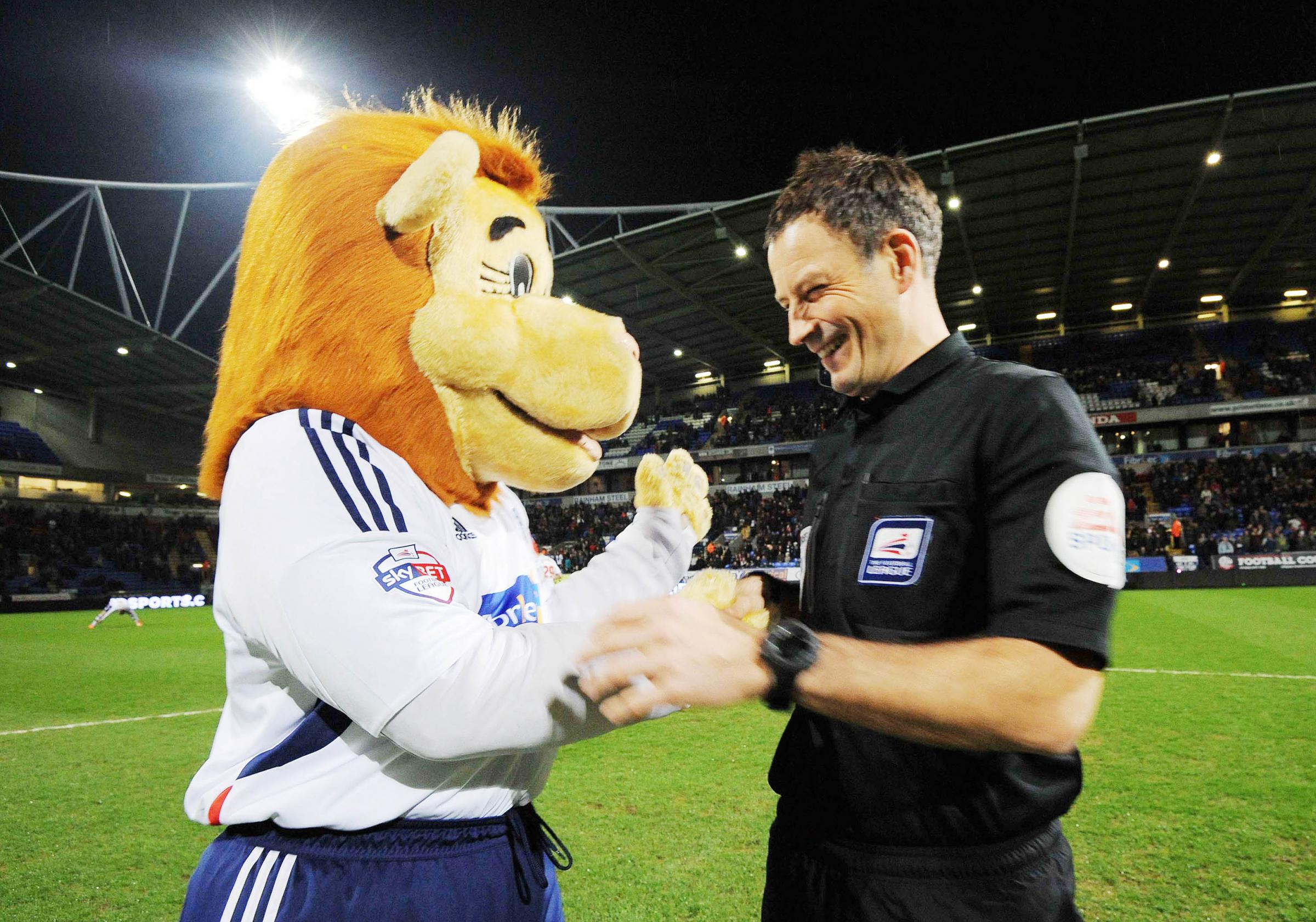 Lofty the Lion jokes with Mark Clattenburg before the Blackpool game