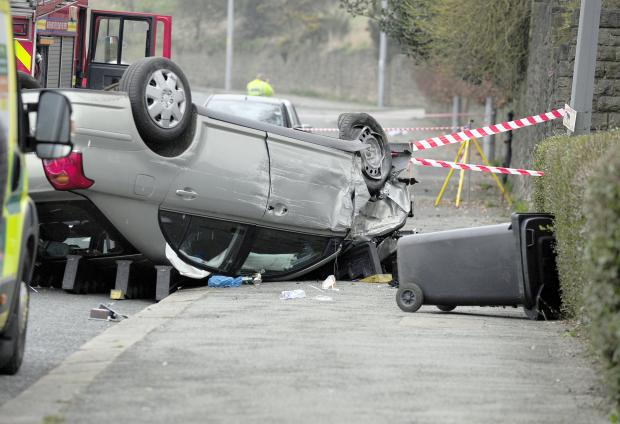 The Bolton News: The car on its roof after the crash in Chorley Old Road