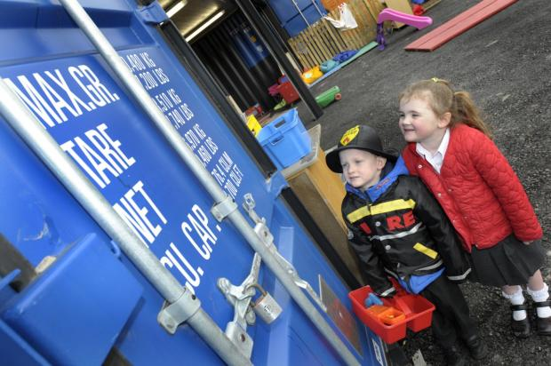 Nursery children Reece Stones and Alica Tranter admire the new nursery building