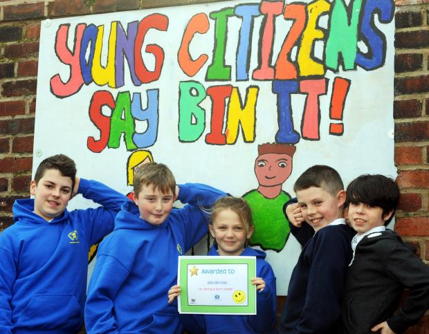 "With their ""Bin It"" artwork and an award certificate are, from left, Rhys Howarth, Jamie Hunt, Morgan Connell, Caden Shakeshaft and Malachi O'Neill"