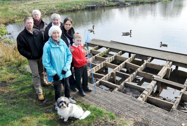 The Bolton News: The ruined pond-dipping platform at Eatock Lodge in Daisy Hill, Westhoughton