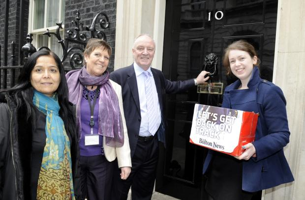 Bolton News reporter Elaine O'Flynn hands in our Let's Get Back on Track Petition to Number 10 Downing Street, with local MPs, from left, Yasmin Qureshi, Julie Hilling and David Crausby