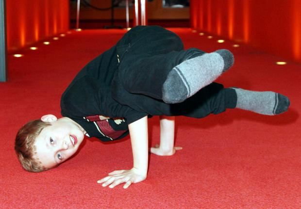 The Bolton News: Tom McKay, aged 11, gets ready for the show