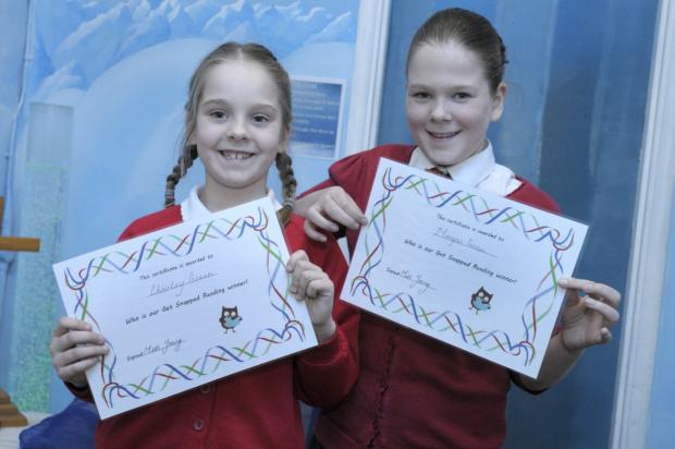 Morgan and Charlie Green completed their reading cards in record time