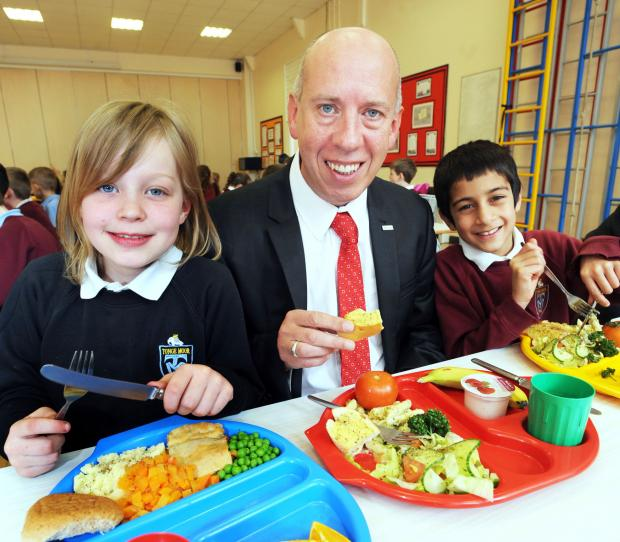 Getting set to tuck in are, from left, Millie Grogan, aged eight, Cllr Nick Peel and Sameer Ahmed, aged eight