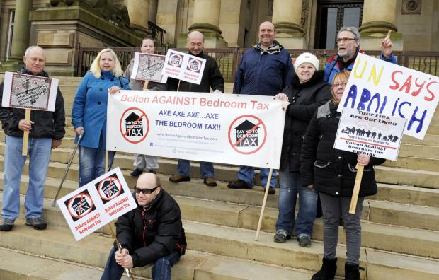 Campaigners against the 'bedroom tax' on the steps of the town hall
