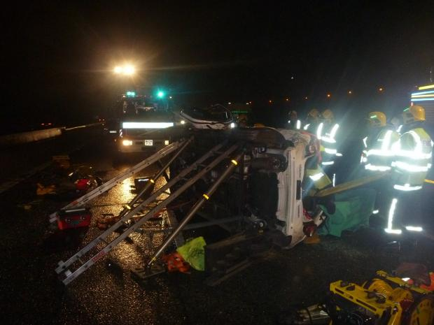 The Bolton News: The crash scene after a Chevrolet overturned on the M61