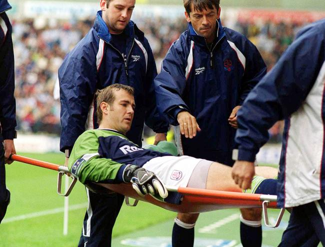 Keith Branagan is carried off at the Reebok - a few years after another injury which was thought to have threatened his career