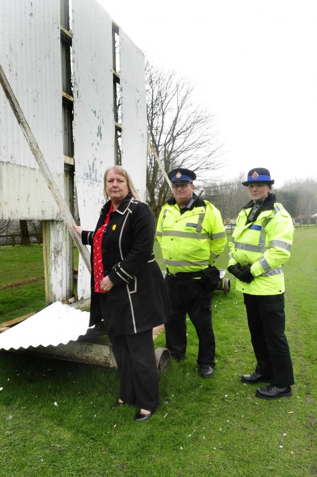 The Bolton News: Karen Waring, secretary of Darcy Lever Cricket Club with PCSOs Maurice Pennington and PCSO Claire Lindop by the damaged sight screens
