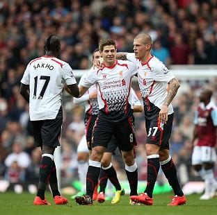 Steven Gerrard, centre, celebrates scoring his side's first goal