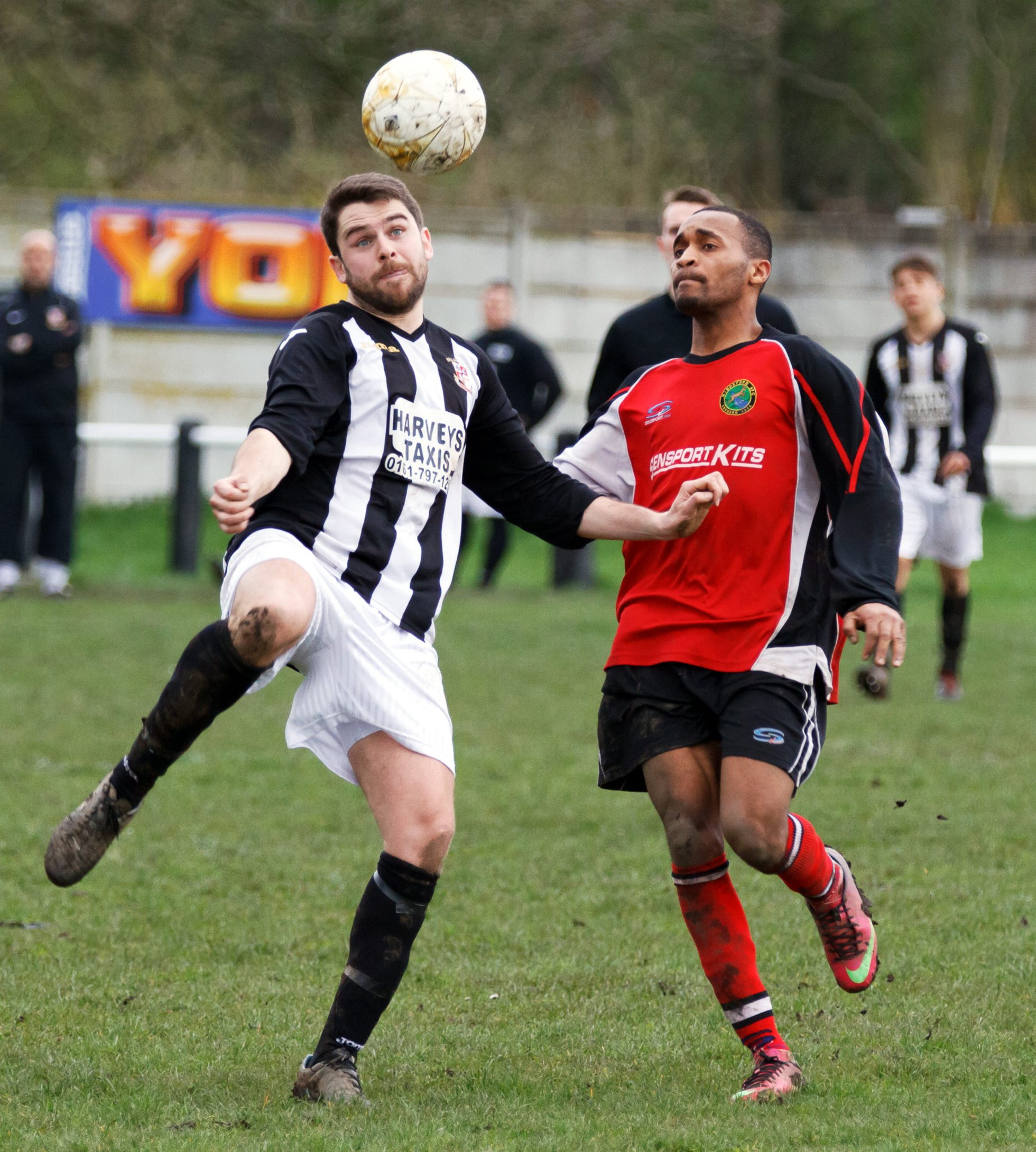 Hindsford's Portuguese striker David Moreno, right, challenges Walshaw Sports' Nicky Barrass. Moreno scored in Hindsford's 2-1 victory