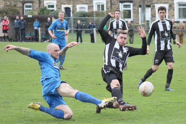 Atherton Collieries' Rob Swanton, right, launches into a tackle