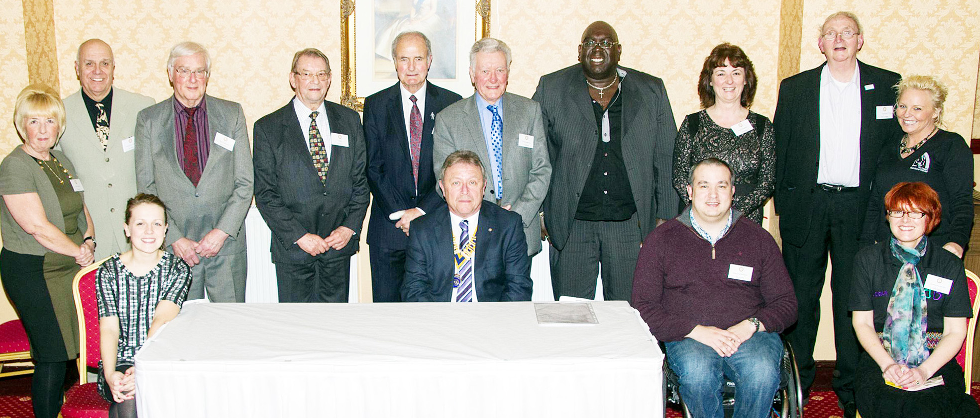 Rotary club president Arthur Price, centre front, with representatives of the charities