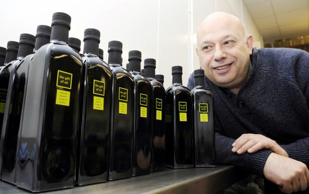 The Bolton News: Phil Bianchi with some of his Gift of Oil products