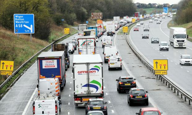 Traffic congestion on M61 at Four Lane Ends after the crash