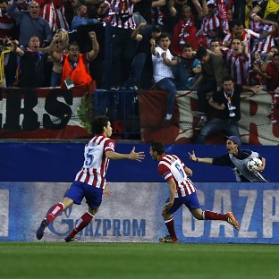 Koke, right, celebrates scoring the opening goal (AP)